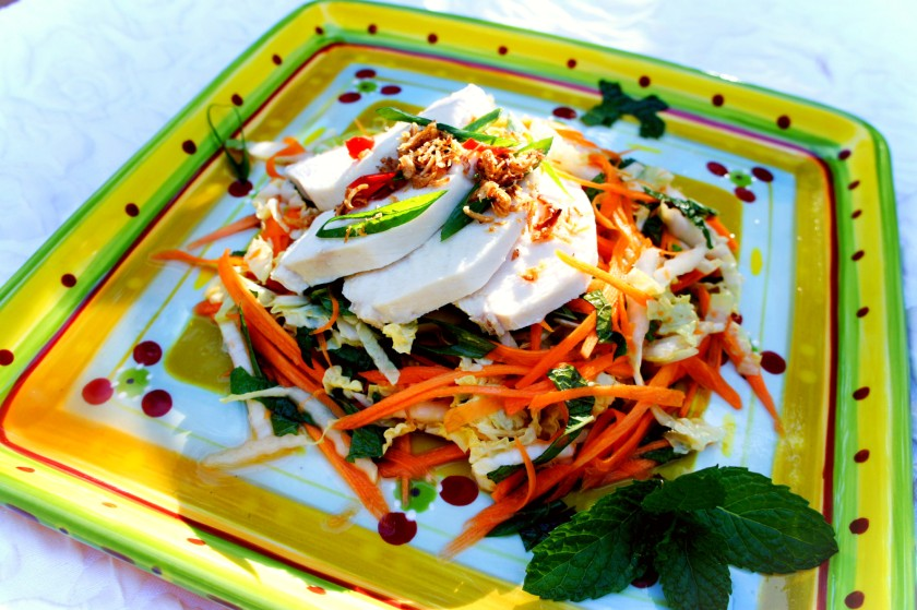 Poached chicken with Asian salad of wombok, pickled carrot, mung bean vermicelli, mint and coriander, serviced with a spicy dressing.