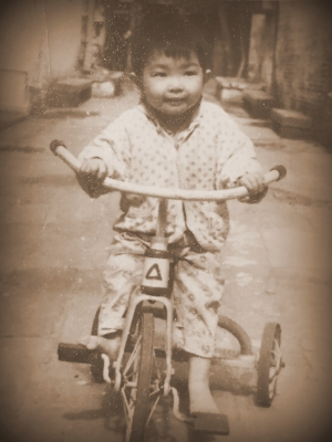 Riding a bike at Yayan Lane, GuangZhou, China in 1970s