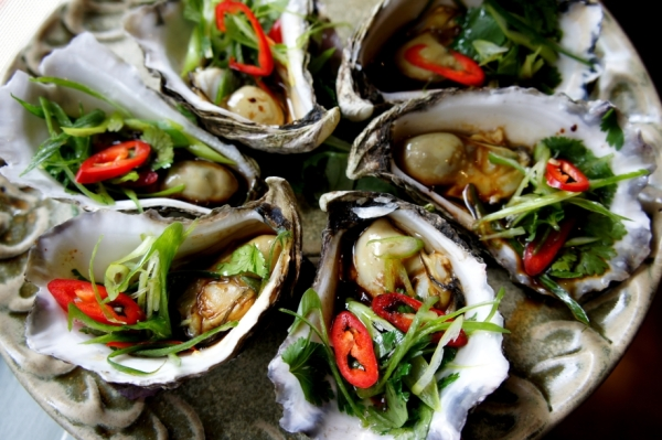 Steamed oysters with soy sauce, sesame oil, shallot, coriander and chili