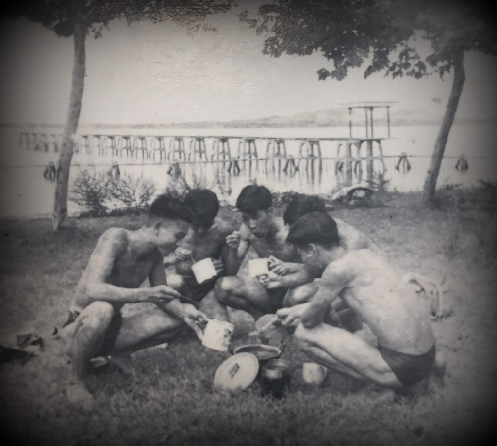 My father and other college students having a picnic after a swimming session,  summer 1961
