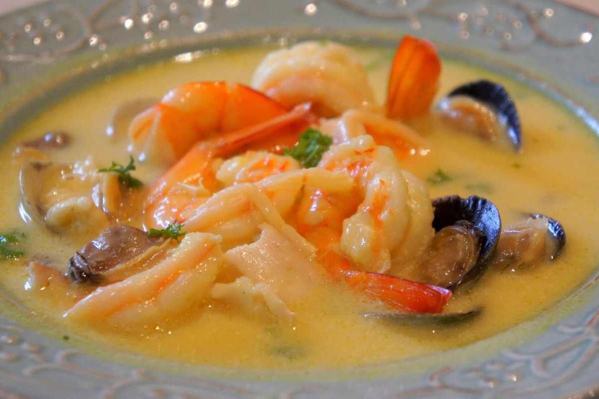 Seafood chowder with clams, prawns and fish