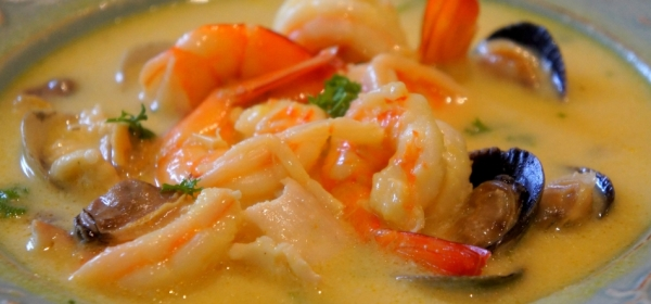Creamy seafood chowder with a hint of turmeric