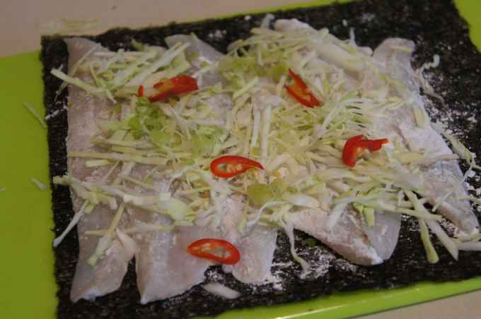 Whiting fillets over nori sheet, with cabbage and chili