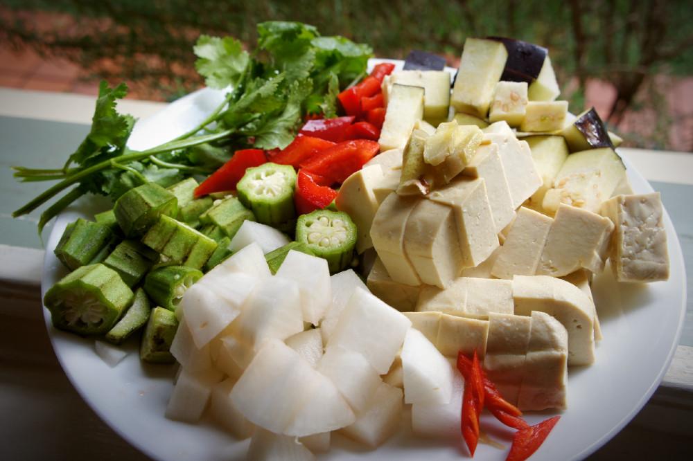 Tofu chop suey ingredients - extra firm tofu, chili, white radish, okra, coriander, capsicum eggplant & ginger