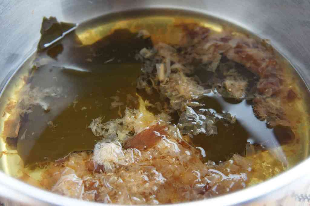 Bonito flakes (Katsuobushi) and kelp cooking in a pot to make dashi