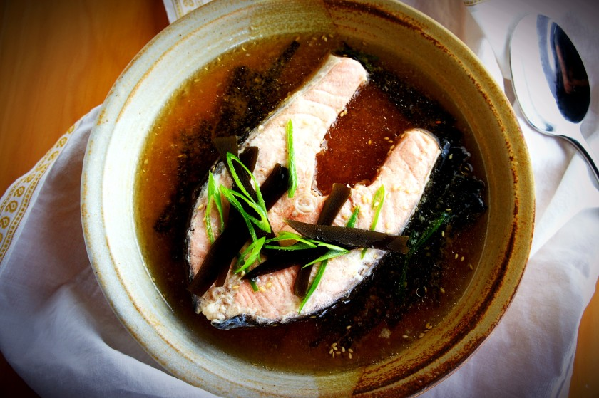 Salmon in a dashi (kelp/seaweed broth with soy sauce)