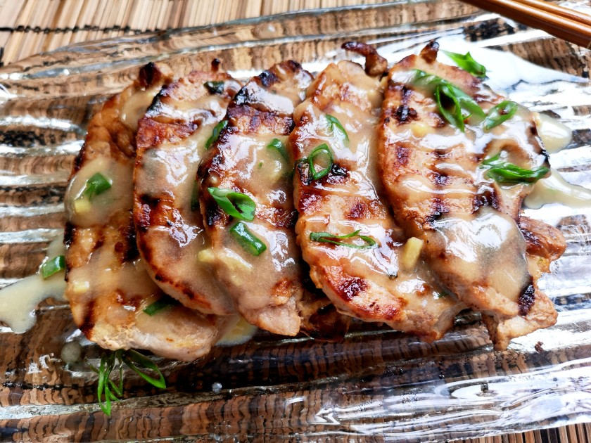 Grilled pork marinated with ginger, white wine, soy sauce and sesame oil
