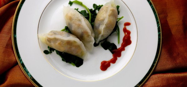 Homemade 'fun guo' (粉果) dumplings with Chinese vegetables and peanuts