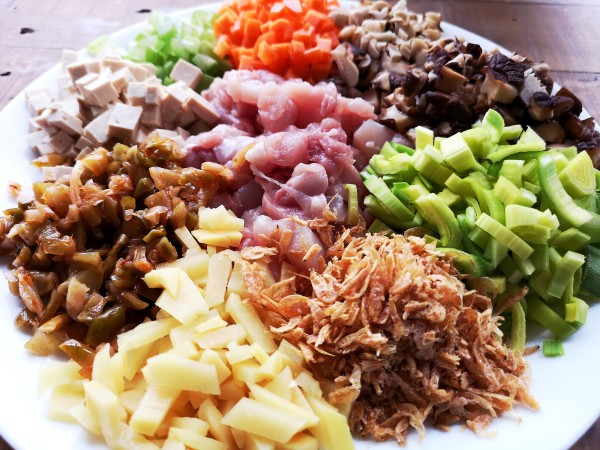 Fun guo ingredients - clockwise from top, carrot, peanuts, Chinese mushroom, leek, shrimp shell, bamboo shoot, pickled turnip, tofu, celery