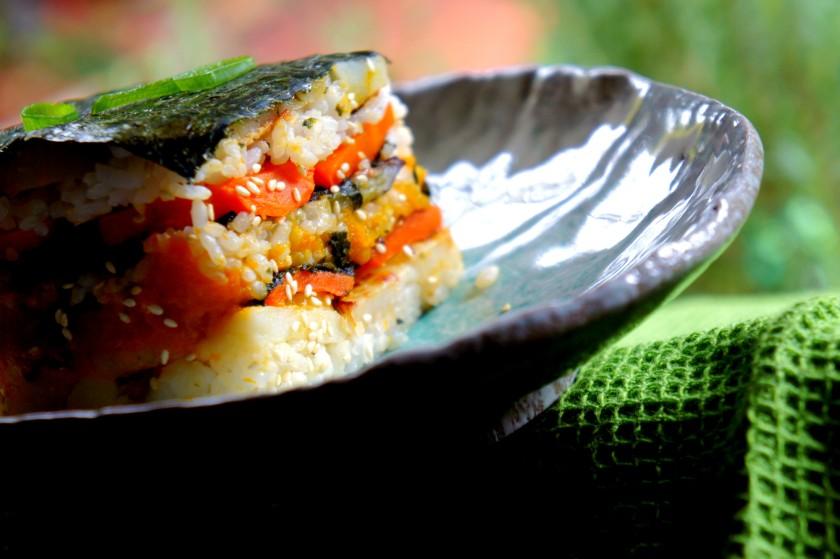 Sushi terrine with rice, sauté pumpkin with cumin, sauté carrot with turmeric, and sauté capsicum with garam masala.