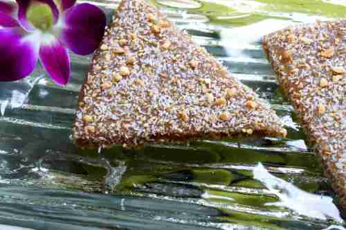 Chinese New Year 'nian gao' with ginger, cinnamon, cadamon, maple syrup, dusted with a peanut, sesame seed and coconut mixture