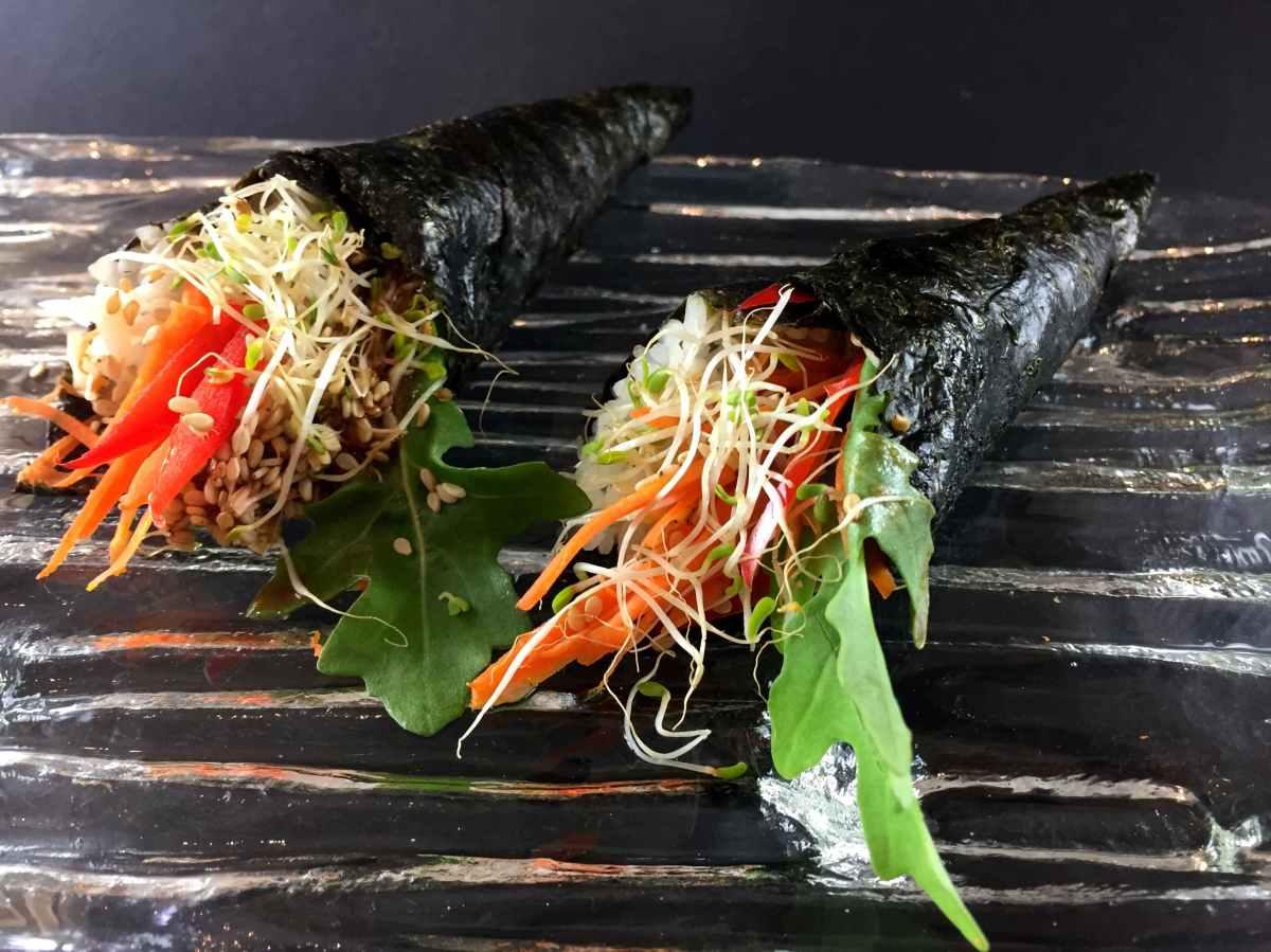 Hand nori rolls of alfalfa, rocket, carrot and sesame seeds. low FODMAP, vegan, gluten free