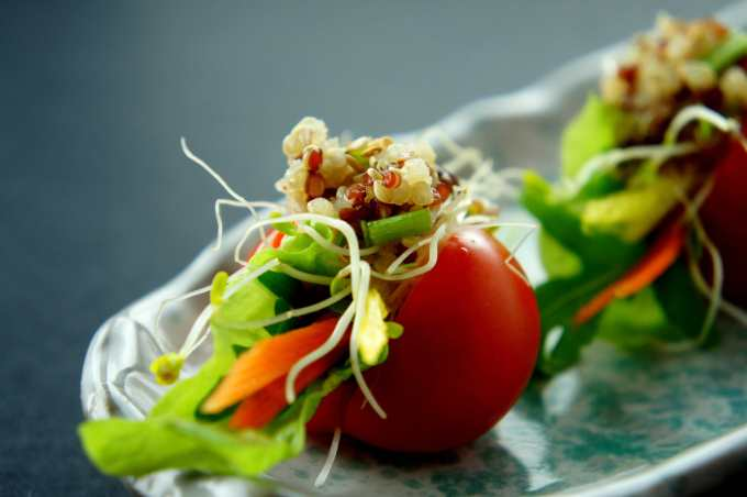 Cherry tomato sandwich with quinoa, coriander and alfalfa