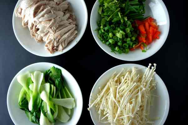 Ingredients for chicken broth - garlic chive, shallot, capsicum, enoki mushroom, bok choy, white cooked chicken