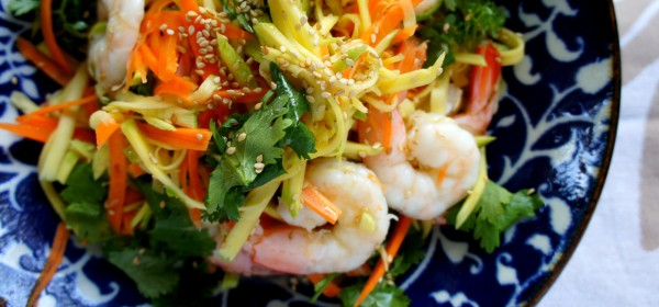Asian salad with mango, and prawns pickled in fish sauce, apple cider vinegar with coriander, green shallot and sesame oil and sesame seeds. Gluten -free.