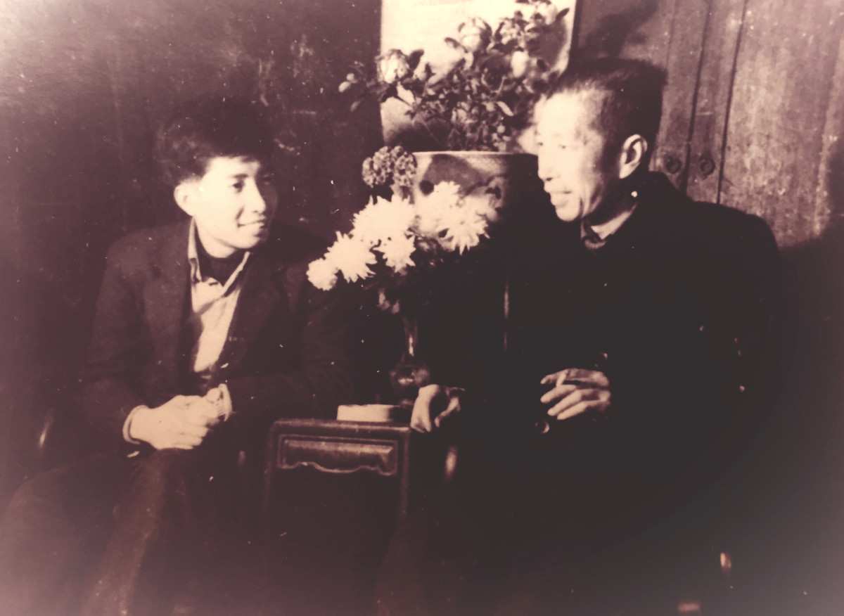 Father and son enjoying a chat at Chinese New Year 1960s