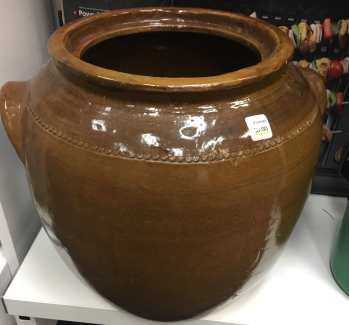 Brown urn for growing bean sprouts