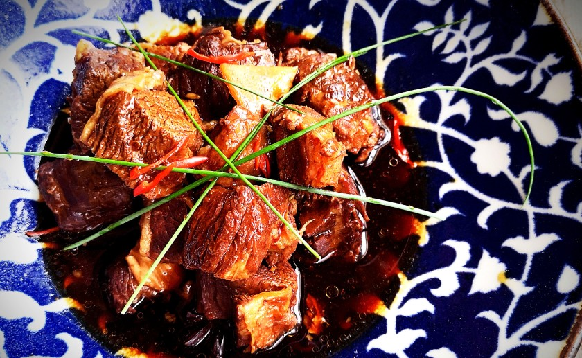 Cantonese style braised beef flank or brisket with soy sauce, star anise, cloves, cinnamon, fennel seeds, cardamom and ginger.